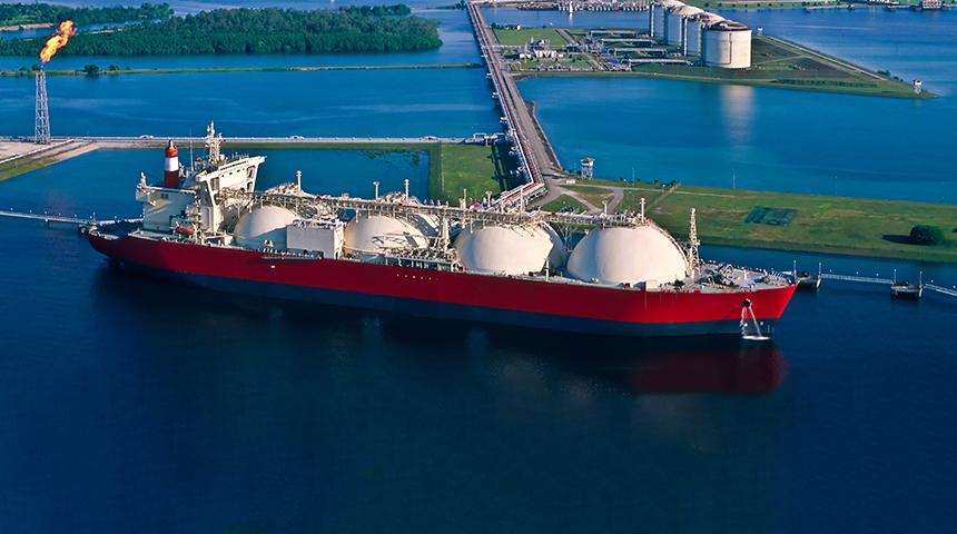 Natural gas tanker at port with LNG liquefaction plant